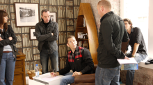 Johnny Carr on set with Simon (assistant director), Mick, Simon and Claire from Different deciding the course of action.